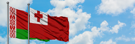 Belarus and Tonga flag waving in the wind against white cloudy blue sky together. Diplomacy concept, international relations.
