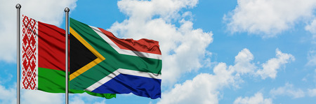 Belarus and South Africa flag waving in the wind against white cloudy blue sky together. Diplomacy concept, international relations. 스톡 콘텐츠