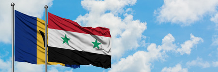 Barbados and Syria flag waving in the wind against white cloudy blue sky together. Diplomacy concept, international relations.