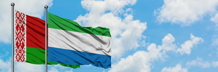 Belarus and Sierra Leone flag waving in the wind against white cloudy blue sky together. Diplomacy concept, international relations. 版權商用圖片