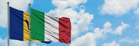 Barbados and Italy flag waving in the wind against white cloudy blue sky together. Diplomacy concept, international relations.
