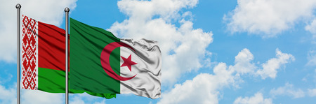 Belarus and Algeria flag waving in the wind against white cloudy blue sky together. Diplomacy concept, international relations.