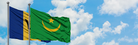 Barbados and Mauritania flag waving in the wind against white cloudy blue sky together. Diplomacy concept, international relations. Фото со стока