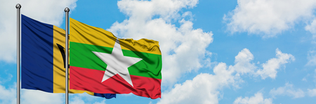 Barbados and Myanmar flag waving in the wind against white cloudy blue sky together. Diplomacy concept, international relations.