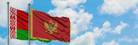 Belarus and Montenegro flag waving in the wind against white cloudy blue sky together. Diplomacy concept, international relations. 版權商用圖片