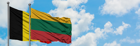 Belgium and Lithuania flag waving in the wind against white cloudy blue sky together. Diplomacy concept, international relations.