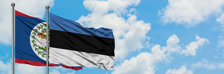 Belize and Estonia flag waving in the wind against white cloudy blue sky together. Diplomacy concept, international relations.