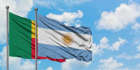 Benin and Argentina flag waving in the wind against white cloudy blue sky together. Diplomacy concept, international relations.