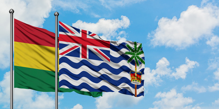 Bolivia and British Indian Ocean Territory flag waving in the wind against white cloudy blue sky together. Diplomacy concept, international relations. Imagens