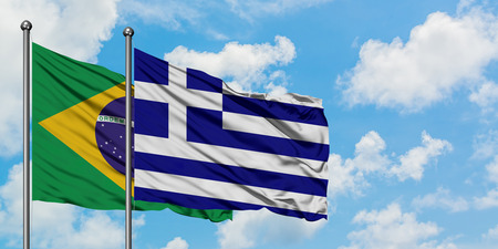 Brazil and Greece flag waving in the wind against white cloudy blue sky together. Diplomacy concept, international relations.