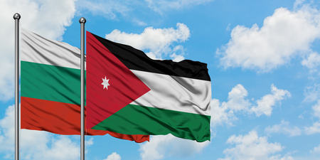 Bulgaria and Jordan flag waving in the wind against white cloudy blue sky together. Diplomacy concept, international relations.