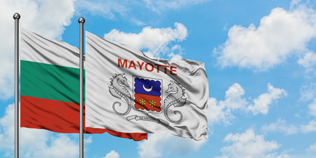 Bulgaria and Mayotte flag waving in the wind against white cloudy blue sky together. Diplomacy concept, international relations.