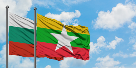 Bulgaria and Myanmar flag waving in the wind against white cloudy blue sky together. Diplomacy concept, international relations.