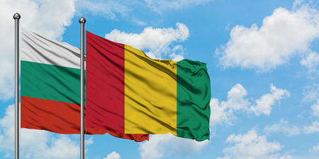 Bulgaria and Guinea flag waving in the wind against white cloudy blue sky together. Diplomacy concept, international relations.