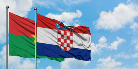 Burkina Faso and Croatia flag waving in the wind against white cloudy blue sky together. Diplomacy concept, international relations.