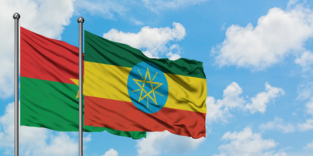 Burkina Faso and Ethiopia flag waving in the wind against white cloudy blue sky together. Diplomacy concept, international relations. Stockfoto