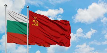 Bulgaria and Soviet Union flag waving in the wind against white cloudy blue sky together. Diplomacy concept, international relations.