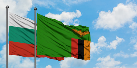 Bulgaria and Zambia flag waving in the wind against white cloudy blue sky together. Diplomacy concept, international relations.