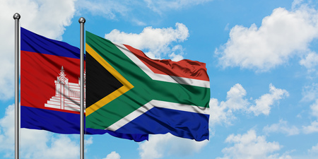 Cambodia and South Africa flag waving in the wind against white cloudy blue sky together. Diplomacy concept, international relations.