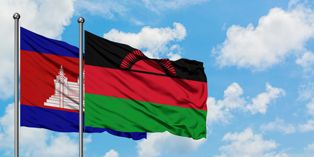 Cambodia and Malawi flag waving in the wind against white cloudy blue sky together. Diplomacy concept, international relations.