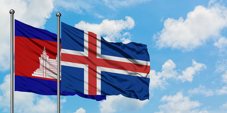 Cambodia and Iceland flag waving in the wind against white cloudy blue sky together. Diplomacy concept, international relations. Stock Photo