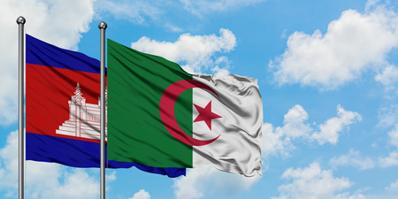 Cambodia and Algeria flag waving in the wind against white cloudy blue sky together. Diplomacy concept, international relations. Stok Fotoğraf