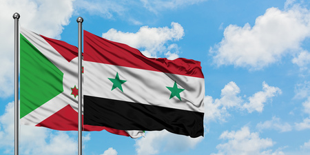 Burundi and Syria flag waving in the wind against white cloudy blue sky together. Diplomacy concept, international relations.