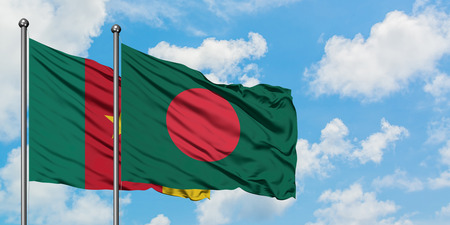 Cameroon and Bangladesh flag waving in the wind against white cloudy blue sky together. Diplomacy concept, international relations.