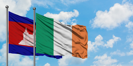 Cambodia and Ireland flag waving in the wind against white cloudy blue sky together. Diplomacy concept, international relations.