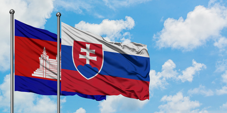 Cambodia and Slovakia flag waving in the wind against white cloudy blue sky together. Diplomacy concept, international relations.