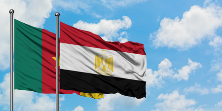 Cameroon and Egypt flag waving in the wind against white cloudy blue sky together. Diplomacy concept, international relations.