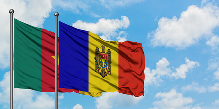 Cameroon and Moldova flag waving in the wind against white cloudy blue sky together. Diplomacy concept, international relations.