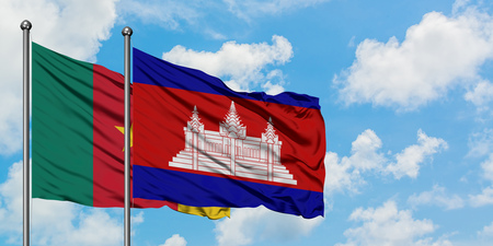 Cameroon and Cambodia flag waving in the wind against white cloudy blue sky together. Diplomacy concept, international relations.