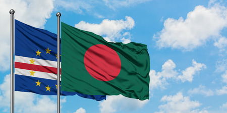 Cape Verde and Bangladesh flag waving in the wind against white cloudy blue sky together. Diplomacy concept, international relations.