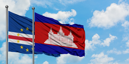 Cape Verde and Cambodia flag waving in the wind against white cloudy blue sky together. Diplomacy concept, international relations. Stok Fotoğraf