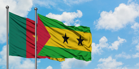 Cameroon and Sao Tome And Principe, flag waving in the wind against white cloudy blue sky together. Diplomacy concept, international relations.