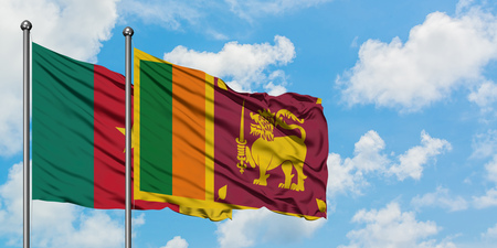 Cameroon and Sri Lanka flag waving in the wind against white cloudy blue sky together. Diplomacy concept, international relations.
