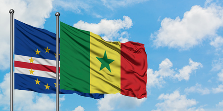 Cape Verde and Senegal flag waving in the wind against white cloudy blue sky together. Diplomacy concept, international relations.