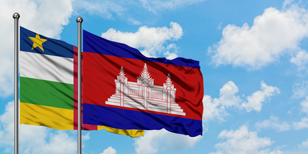 Central African Republic and Cambodia flag waving in the wind against white cloudy blue sky together. Diplomacy concept, international relations.
