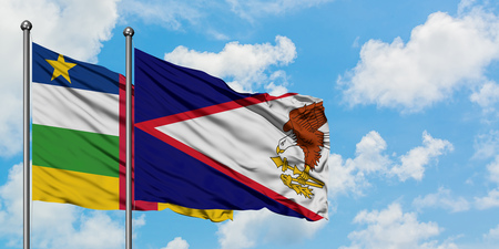 Central African Republic and American Samoa flag waving in the wind against white cloudy blue sky together. Diplomacy concept, international relations. 스톡 콘텐츠