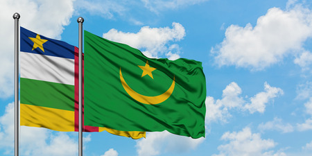 Central African Republic and Mauritania flag waving in the wind against white cloudy blue sky together. Diplomacy concept, international relations.