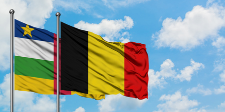 Central African Republic and Belgium flag waving in the wind against white cloudy blue sky together. Diplomacy concept, international relations. 스톡 콘텐츠