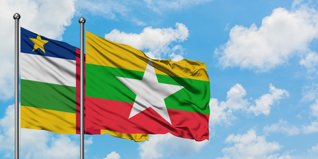 Central African Republic and Myanmar flag waving in the wind against white cloudy blue sky together. Diplomacy concept, international relations.