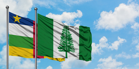 Central African Republic and Norfolk Island flag waving in the wind against white cloudy blue sky together. Diplomacy concept, international relations. 스톡 콘텐츠