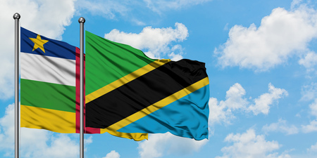 Central African Republic and Tanzania flag waving in the wind against white cloudy blue sky together. Diplomacy concept, international relations. Stock fotó