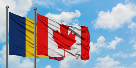 Chad and Canada flag waving in the wind against white cloudy blue sky together. Diplomacy concept, international relations.