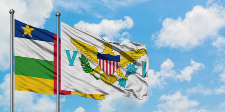 Central African Republic and United States Virgin Islands flag waving in the wind against white cloudy blue sky together. Diplomacy concept, international relations.