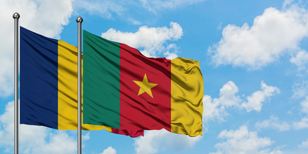 Chad and Cameroon flag waving in the wind against white cloudy blue sky together. Diplomacy concept, international relations.