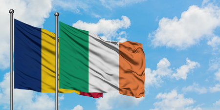 Chad and Ireland flag waving in the wind against white cloudy blue sky together. Diplomacy concept, international relations.