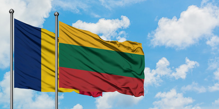 Chad and Lithuania flag waving in the wind against white cloudy blue sky together. Diplomacy concept, international relations.